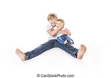 portrait of child little boy holding baby on studio white background