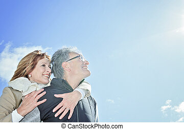 Portrait of happy senior couple in winter season - A ...