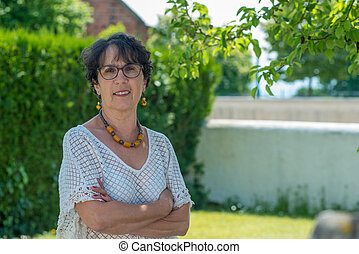 portrait of mature brunette in the garden
