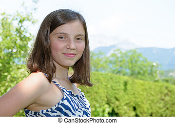 portrait of pretty beautiful young teenager, outdoors