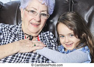 Portrait of smiling multigeneration family spending leisure time