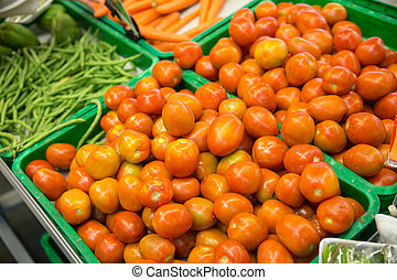 Tomatoes in trays in a market