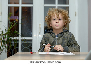 portrait of young blond curly boy