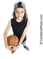 Portrait of young boy with basket ball