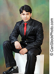 young indian man looking with confidance