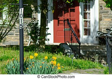 A Post With an Address Number In a Suburban Front Yard