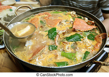 A pot of crab soup
