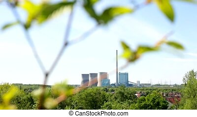 A Power plant with sky and plants