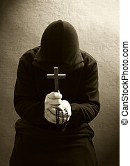 A praying christian monk - A monk praying with a rosary and ...