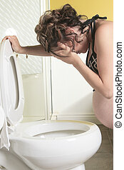 Pregnant woman having morning sickness during Pregnancy. Concept