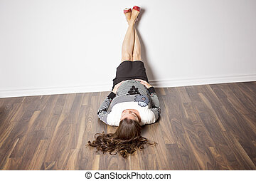 pregnant woman laying on the floor