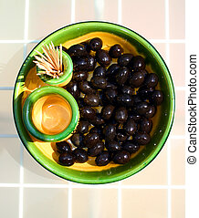 A presentation of bl - black olives in yellow and green...