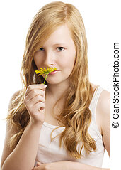 A pretty girl with a yellow flower, isolated