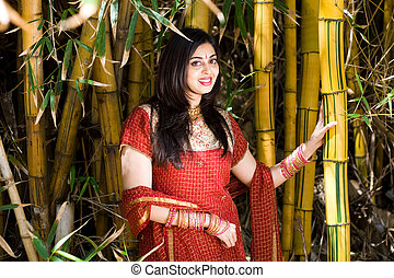 woman - a pretty woman posing next to yellow bamboo