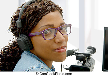pretty young African American woman video editor