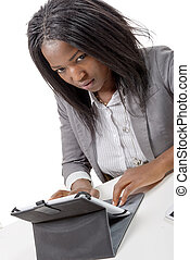 pretty young african american woman with a tablet computer