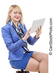 pretty young blonde woman with a tablet, sitting on a stool
