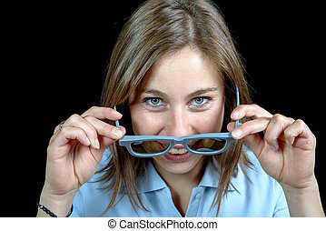 a pretty young girl looking at with 3d glasses