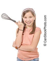 pretty young girl with a whisk for cooking