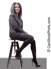 pretty young woman afro american businesswoman sitting on a stool
