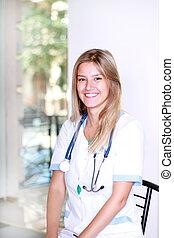 A pretty young woman nurse inside hospital building