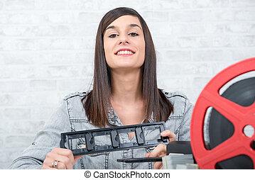 pretty young woman technician scanning film slide