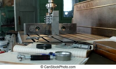 A private workshop for working with metal parts, in the...