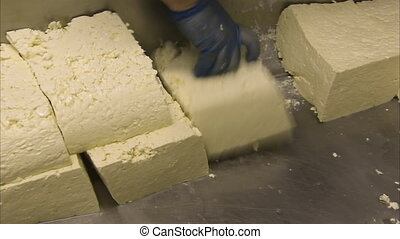 A processed cheese shot - A medium shot of a person fixing a...