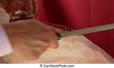 cutting iberico ham