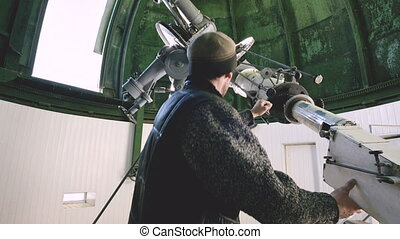 A professional engineer observer of a solar coronagraph at a...