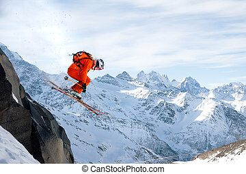 A professional skier makes a jump-drop from a high cliff...