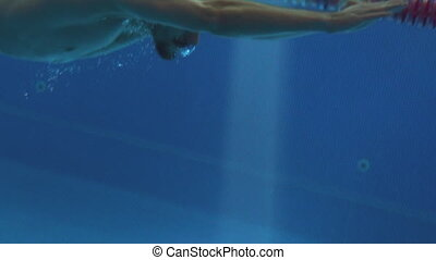 A professional swimmer swimming a breaststroke, camera...