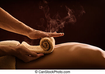 Hot towel compress. SPA treatment - A professional therapist...