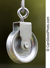 pulley - a pulley hanging on the wire garden