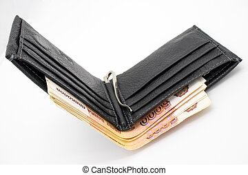 A purse with money on a white background and a hand that counts bills.