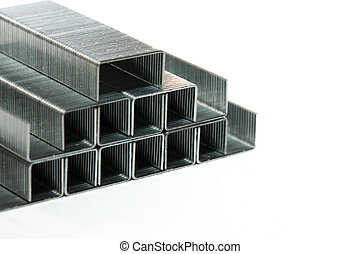 A pyramid of metal staples