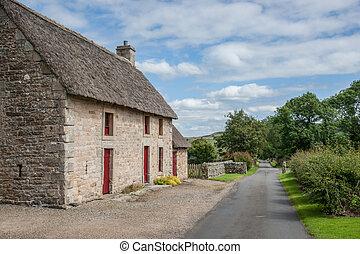 English stone cottage - a quaint English stone cottage with...