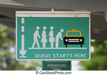 A \'Queue Starts Here\' sign