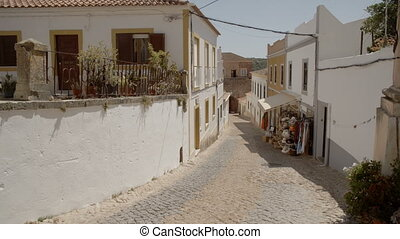 A quiet Portuguese alleyway with a local shop - A still shot...