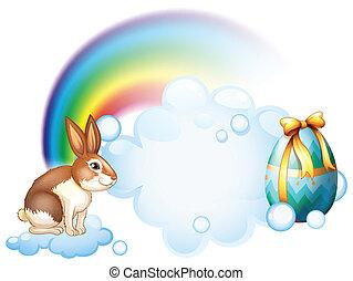 A rabbit and an egg near the rainbow