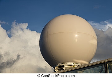 A radar dome on a ship