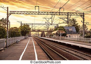 Railway track on the orange sunset