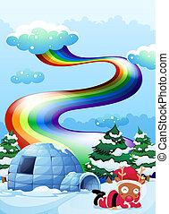 A rainbow above the igloo beside the reindeer