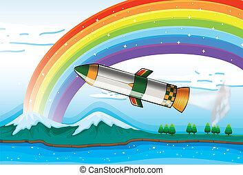 A rainbow above the ocean and an aircraft