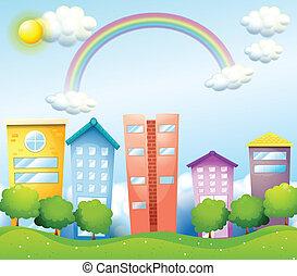 A rainbow above the tall buildings