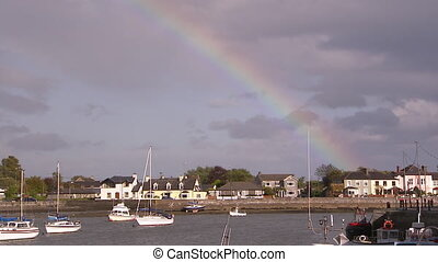 A rainbow over a pier in Ireland - A steady shot from a...