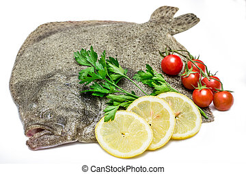a raw turbot fish with lemon slices,cherry tomatoes and ...
