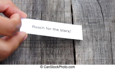 Reach for the stars - A Reach for the stars paper sign on...