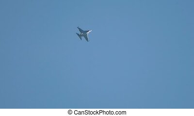 A reactive military plane flying up in the blue clear sky....