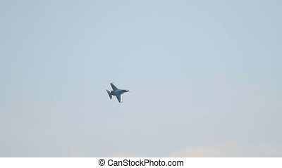A reactive military plane lonely flying up in the clear sky....